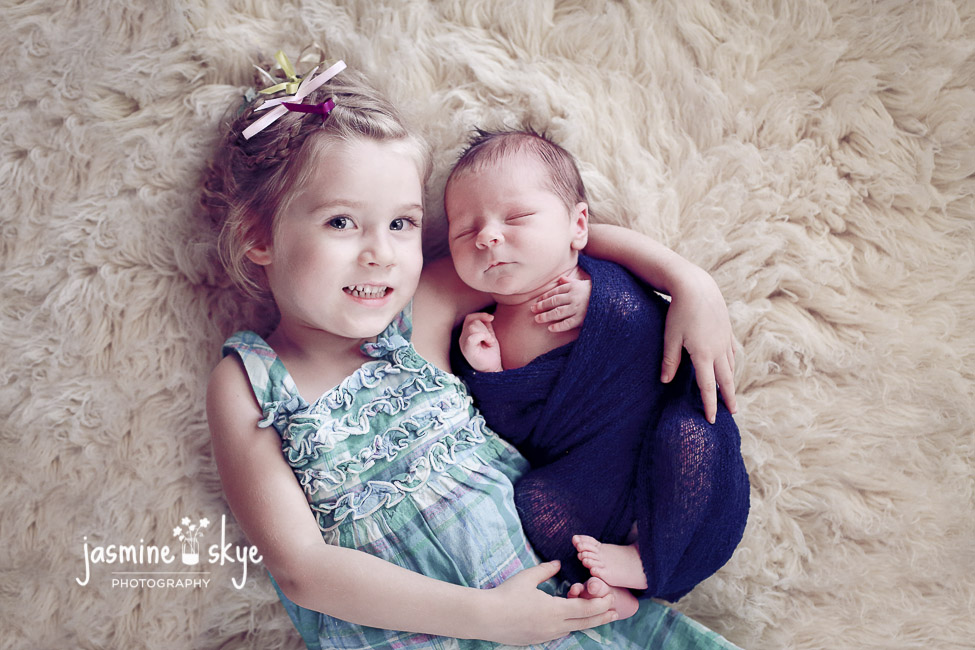 newborn with sibling photos