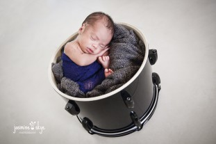 newborn in a drum photos